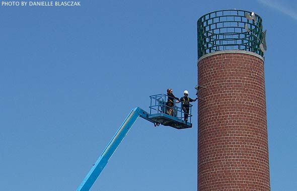 Smokestack being installed